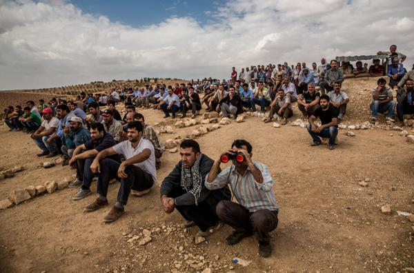 KURDS WATCH KOBANE SYRIA FIGHTING