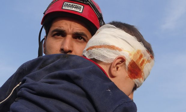white-helmet-abdullah-rescues-child