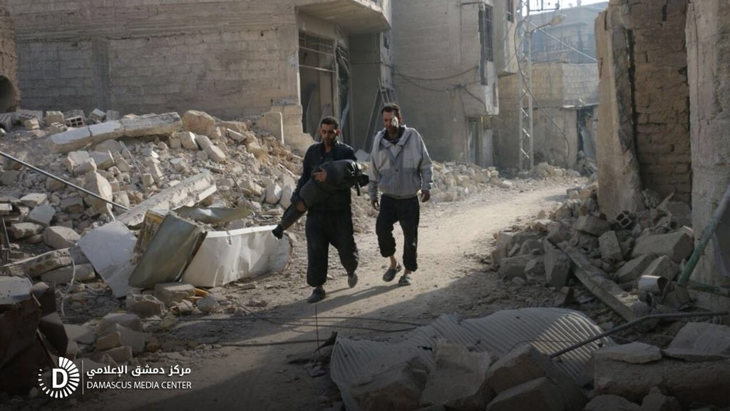 EAST GHOUTA FATHER CARRIES DAUGHTER