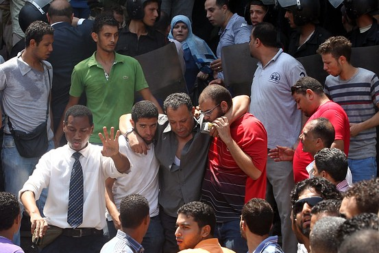 Egypt Feature: Gunfire & Trapped Protesters in Cairo Mosque