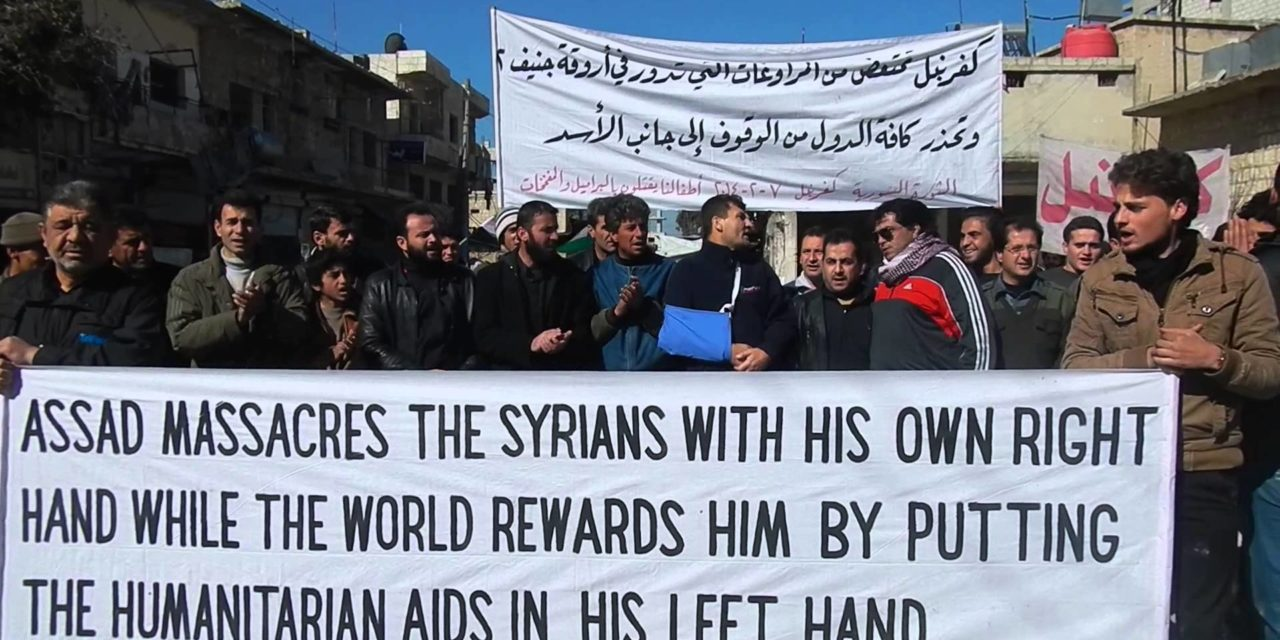 "Syria: Raed Fares At Kafranbel Friday Protest – ""Assad Massacres Civilians, World Rewards Him With Aid"""
