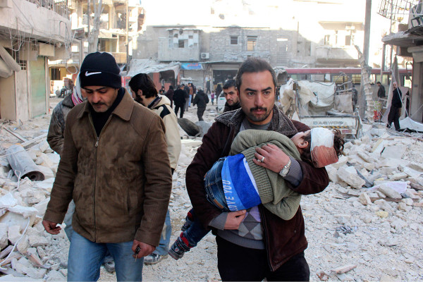 SYRIA MAN WITH INJURED CHILD
