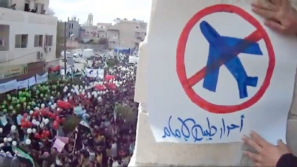 A Syrian demonstrator calls for a no-fly zone