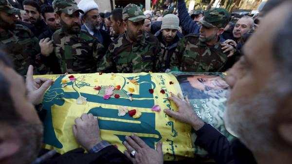 Hezbollah members gather around the coffin of Hezbollah militant leader Samir Qantar during his funeral in Beirut's southern suburbs, Lebanon December 21, 2015.  REUTERS/Jamal Saidi
