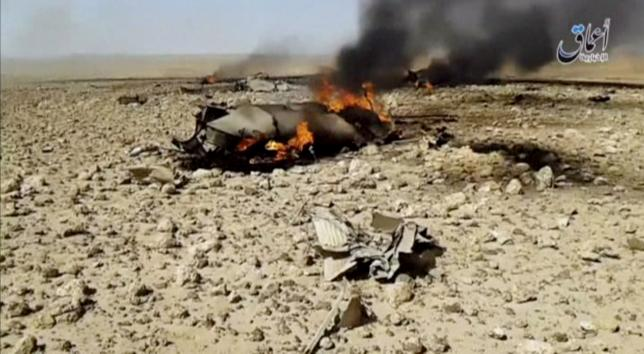 A view of the burning wreckage of a plane that crashed southeast of Damascus, Syria in this still image taken from video said to be shot April 22, 2016.  Social Media Website via Reuters TV