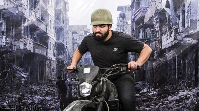 """Iran Photo Feature: Tehran Rallies Public at Book Fair — """"You Can Pose as A Fighter in Syria"""""""