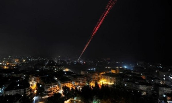 Govermental Syrian forces fires into sky as celebrating their victory against rebels in eastern Aleppo