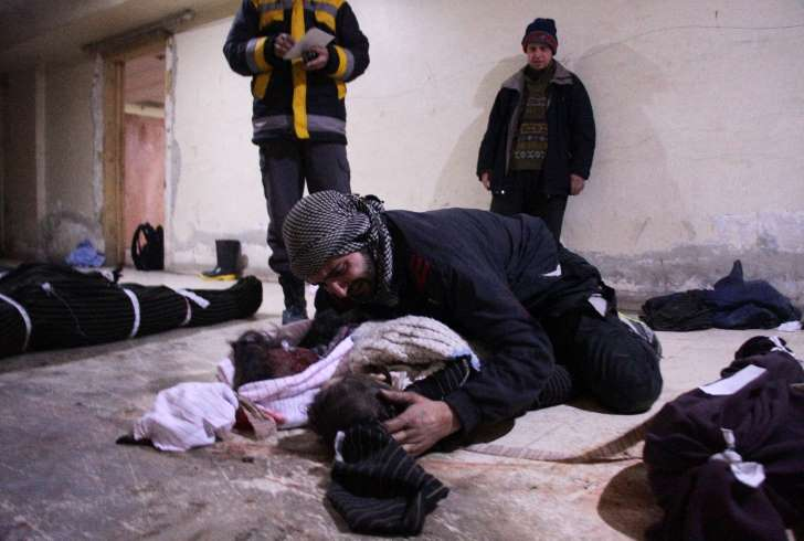 Unfolding Little Shrouds in East Ghouta —- A Scene from the Mass Killing of Civilians