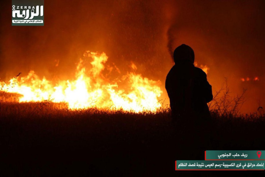 Crops burn in southern Aleppo Province, Syria after bombing by pro-Assad forces