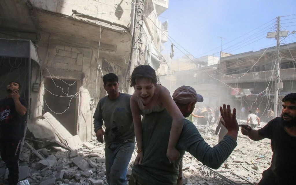 Boy cries as he is rescued after pro-Assad bombardment of Idlib Province, Syria, May 2019