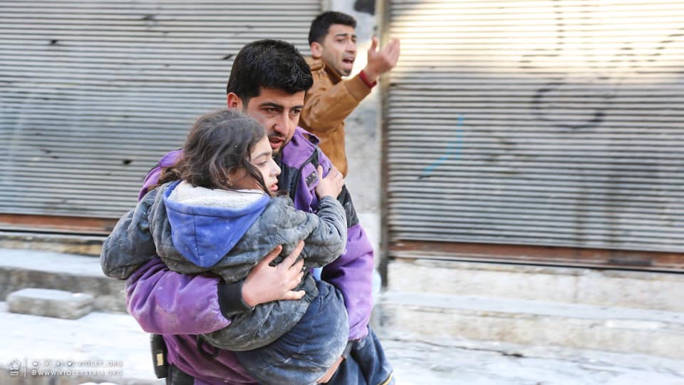 A man carries a girl away from site of Assad regime attack on Idlib Province in northwest Syria, June 20, 2019