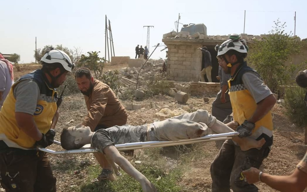 White Helmets rescue victim of pro-Assad bombing of Babulin in northwest Syria, June 7, 2019