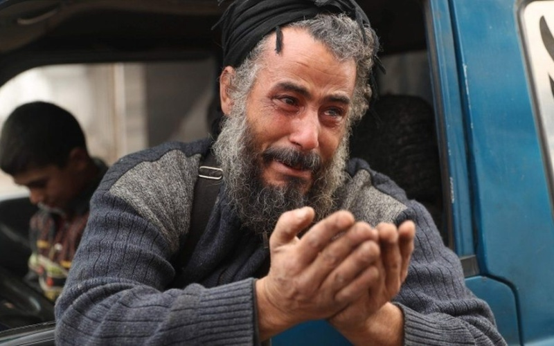 A man sobs as he is forced from his home in Ma'arat al-Num'an, Syria