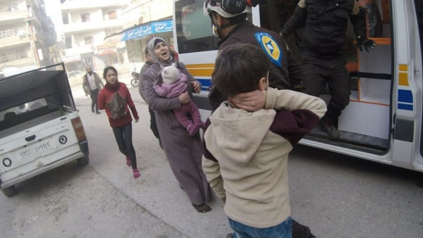 A mother carries her baby after deadly Russia-regime attack in Idlib Province in northwest Syria, January 15, 2020