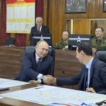 Syria Daily: Putin Visits Assad