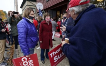 Republican Sen. Susan Collins, center, campaigns Thursday, Oct. 29, 2020, in Cornish, Maine. Collins is seeking re-election against Democratic challenger Sara Gideon, the speaker of the Maine House. (AP Photo/Robert F. Bukaty)