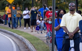 Line on first day of early voting in Georgia (Nathan Posner/REX)