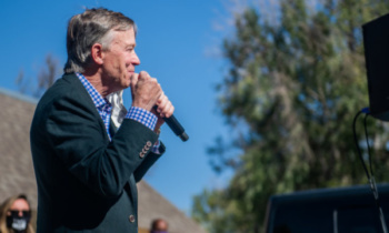 John Hickenlooper at a rally in the parking lot of a restaurant in Fort Collins, Colorado, October 13, 2020 (Lucy Morantz/The Collegian)
