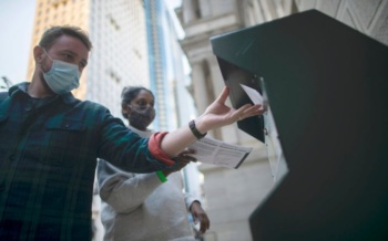Voters cast early ballots at a dropbox outside City Hall, Philadelphia, Pennsylvania, October 17 (Mark Makela/Getty)
