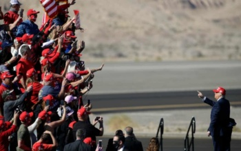 Donald Trump waves at supporters in Bullhead, Arizona, October 28, 2020