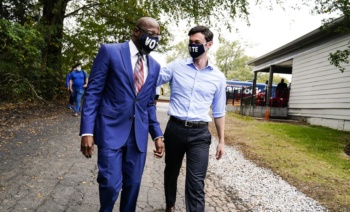 Democratic candidates for Senate, Rev. Raphael Warnock (L) and Jon Ossoff arrive for a campaign event in Jonesboro, Georgia, October 27 (Brynn Anderson/AP)
