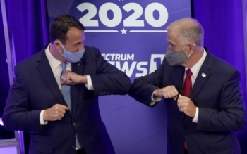 Democratic challenger Cal Cunningham (L) and Sen. Thom Tillis greet each other after a TV debate, Raleigh, North Carolina, October 1, 2020 (Gerry Broome/AP)