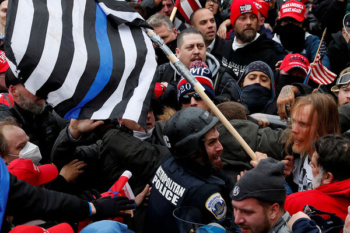 Trump supporters clash with police outside the Capitol, January 6, 2021 (Photo: Shannon Stapleton/Reuters)