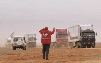 A Syrian Red Crescent worker with a rare aid convoy in the Rukban camp in southeast Syria in 2019